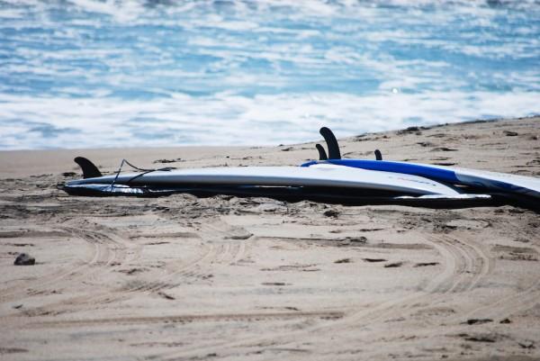 Surfboards take a break during a heavy-surf advisory at Zuma Beach in Malibu