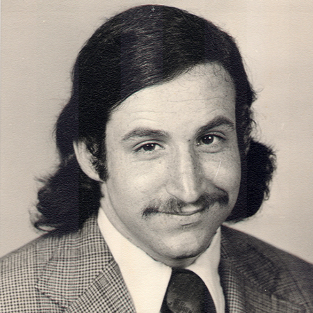 """My """"graduation"""" photo taken in Berkeley in the fall of 1974. I graduated in March 1975, but had the picture taken in a studio on University Avenue because I needed it for grad-school applications. I can't recall now why I had a tie and a jacket."""