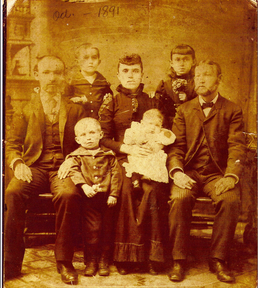 "The Strubers, handwritten note on the photo indicates it was taken in Oct. 1891.  L to R: Mendel ""Max"" Struber, his sons Bill Struber, Sam Struber, his wife Nellie (Becker) Struber, his son Jack Struber, his daughter Annie Struber, and his brother Sruel ""Israel"" Strauber. (Collection of Victor R. Struber)"
